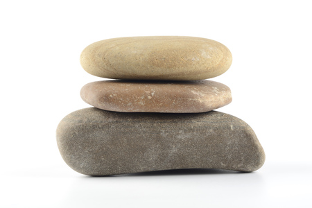 Boulders stacked on white background, stones stacked