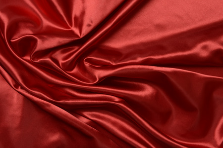 Effects of light in one red satin fabric, abstract composition Stock fotó