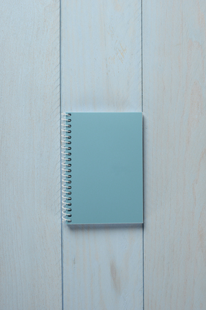 Blue notebook on blue wooden background, concept 写真素材