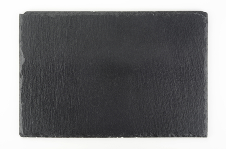 Rectangular slate stone dish seen from above on white background 스톡 콘텐츠