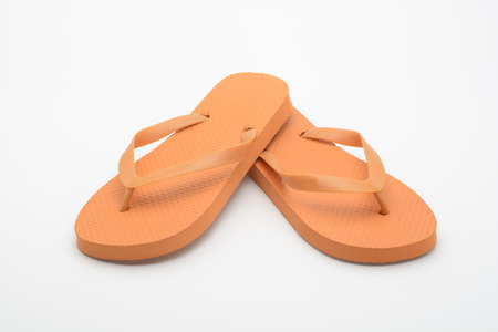 Orange flipflops on white background