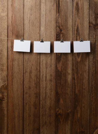 Cards hanging on a rope over brown wooden Stock Photo - 118517884