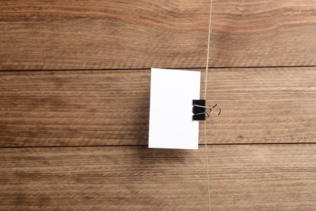 Card hanging on a rope over brown wooden