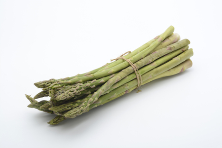 Raw asparagus on white background Standard-Bild