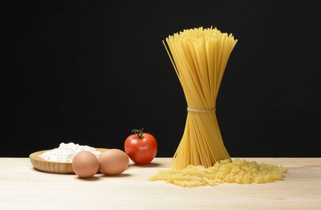 Raw pasta tagliatelle, elbows and penne