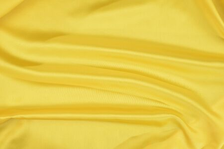 Effects of light in one yellow satin fabric