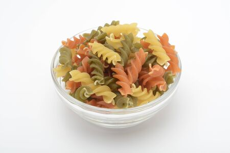 Tricolor spiral pasta, raw food