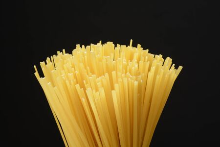 Raw pasta tagliatelle, macro detail