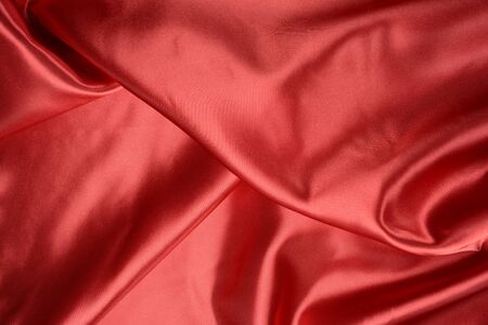 Effects of light in one red satin fabric