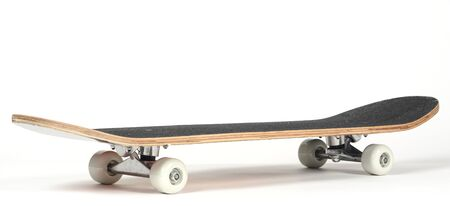Black skateboard on white background Фото со стока