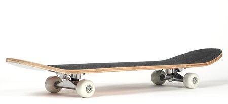 Black skateboard on white background
