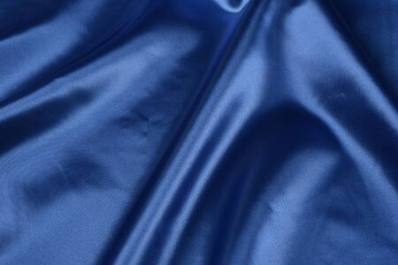 Effects of light in one blue satin fabric