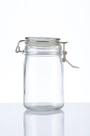 Empty glass jar on white background
