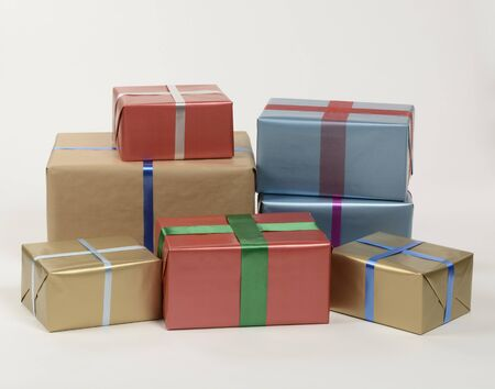 Gift boxes of different colors on white background