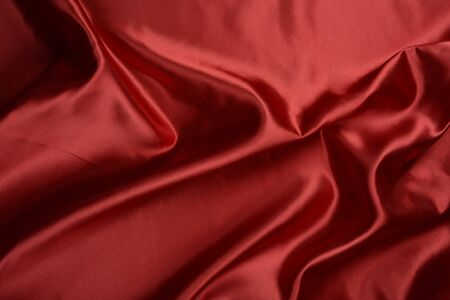 Effects of light in one red satin fabric Stockfoto