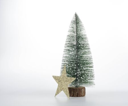 Christmas decorative tree and star on white background