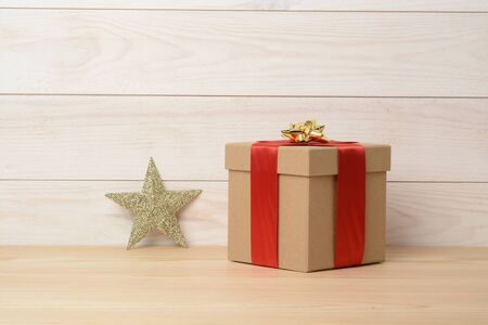 Gift box on wooden white background, white wood Stock Photo
