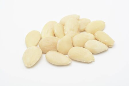 Some raw almonds on white background