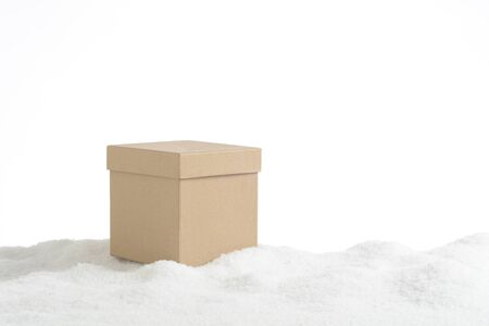 Gift box in the snow, white background