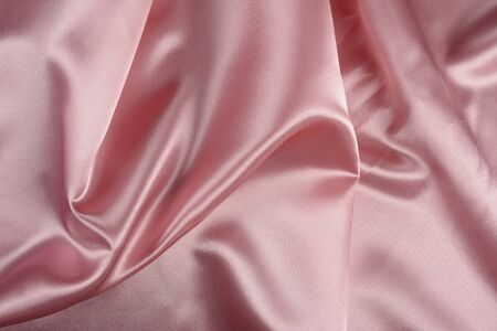 Effects of light in one light pink satin fabric