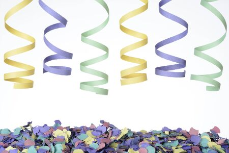 Detail of confetti and ribbons on white background Stockfoto