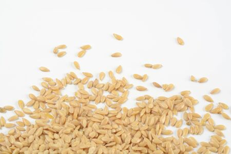 Golden flax seeds on white background, detail