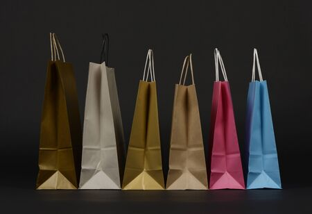 Paper bags for purchase, on black background Фото со стока