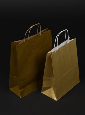 Paper bags for buying gold or yellow, on a black background