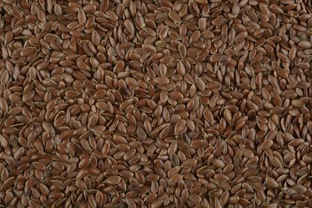Brown flax seeds, photo composition as background Фото со стока