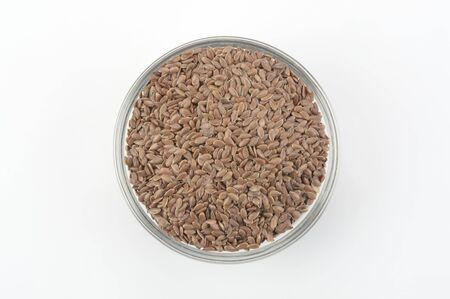 Brown flax seeds in a glass bowl, view from above Stock fotó