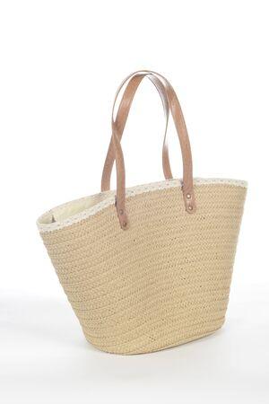 Wicker beach bag on white background