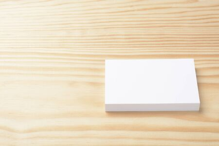 Blank commercial business cards wad on wooden background 写真素材