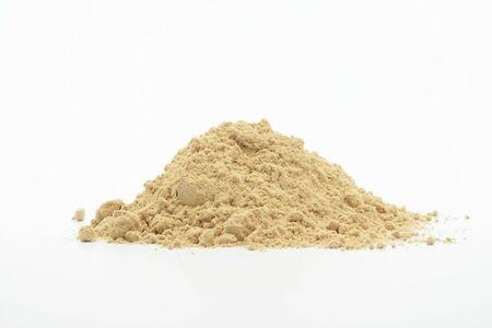 Ground ginger on white background