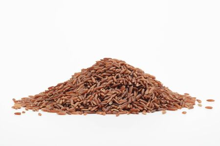 Raw wholegrain red rice on white background