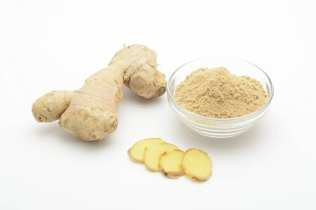 Ginger root and ground on white background