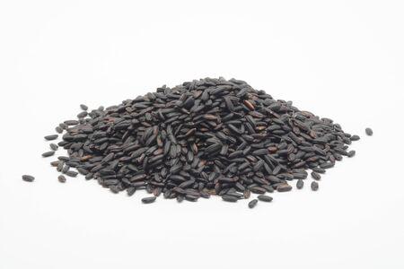 Raw black rice on white background Reklamní fotografie