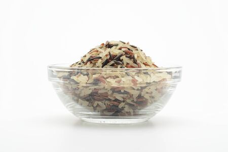 Tricolor rice (red, black and steamed) in a glass bowl on white background 写真素材