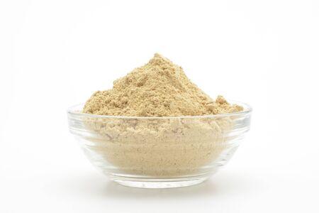 Ground ginger in a glass bowl on white background Reklamní fotografie