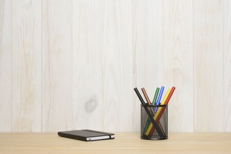 Office items on brown and white wooden background