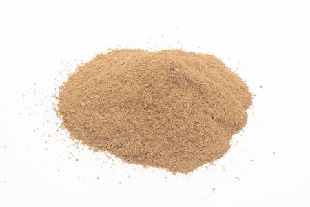 Ground cinnamon on white background Reklamní fotografie