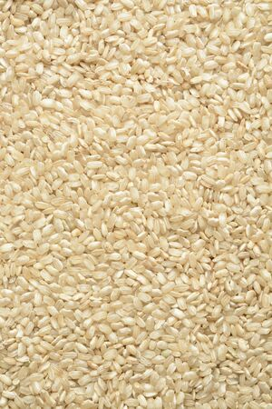 Raw wholegrain rice, composition as a background