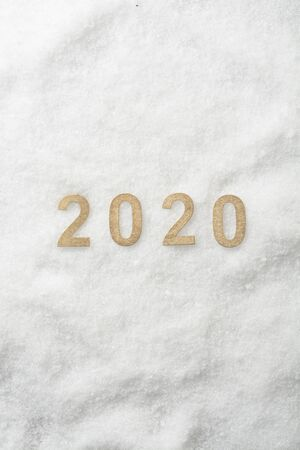 New Year 2020 in numbers on snow background, white and yellow colors Reklamní fotografie
