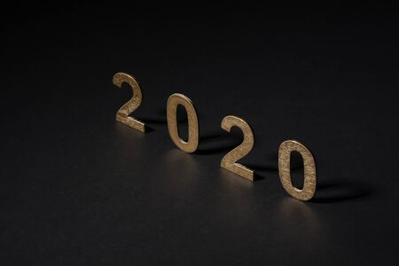 New year 2020 in golden numbers on white background, composition as a postal