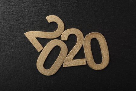 New Year 2020 in wooden numbers on black background