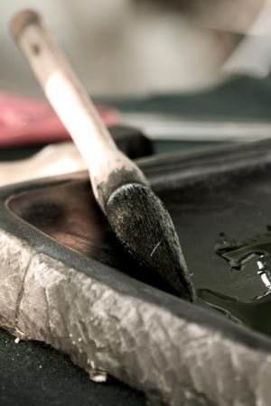 inkstone: Chinese writing brushes and inkstone on the table