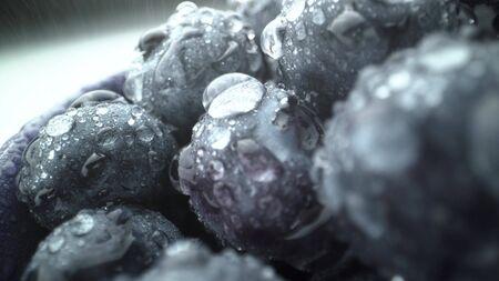 Wet fresh Blueberry background. raw organic tasty healthy food.