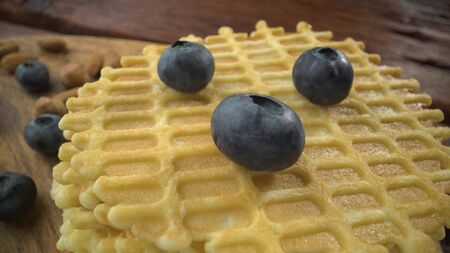 Homemade waffles with berries in plate on grey wooden table. Stok Fotoğraf
