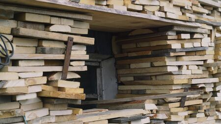 Stacks of Firewood. Preparation of firewood for the winter. Pile of Firewood.Firewood background Stok Fotoğraf