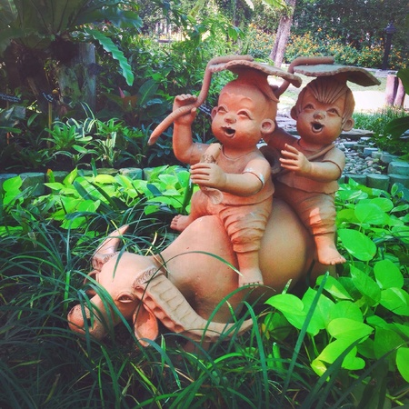 childen: Thai happiness childen on buffalo, clay toy