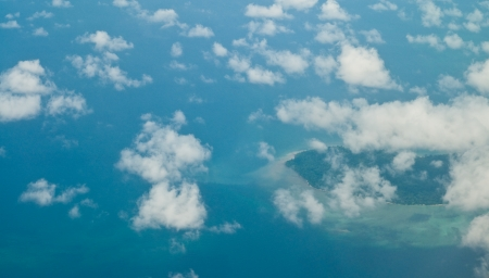 Horizon photo of island with white cloud and sea photo